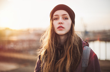 Portrait of a hipster girl at sunset