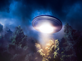 Poster UFO High contrast image of UFO flying over a forest with light beam at night