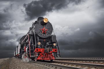 Vintage steam train in motion