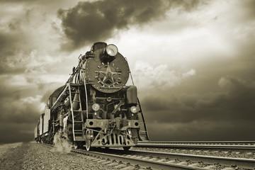 Steam locomotive belching steam and smoke _