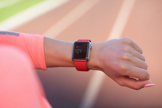 Sport woman looking at smart watch during training