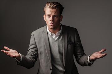 Confident sharp dressed man in grey jacket