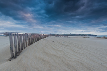 Papiers peints Plage Cloudscape over beach and ocean in Spain, before storm