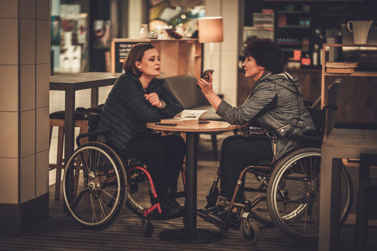 Two physically challenged women in a cafe