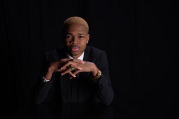 African American businessman sitting at black desk