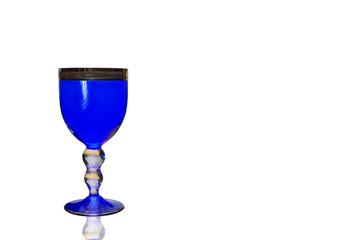 Blue wine glass closeup isolated
