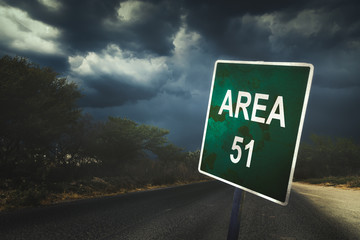 Area 51 sign on a road with dramatic lighting Wall mural