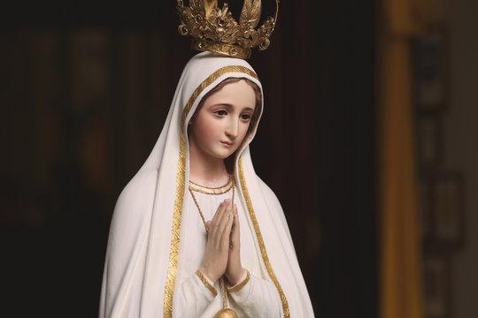 Mother Mary Statue in Catholic Church Praying virgin saint woman women