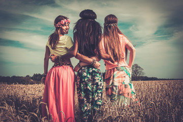 Multi-ethnic hippie girls in a wheat field