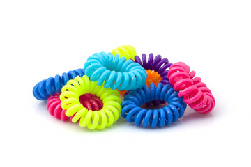 Multicolored rubber bands for hair from a telephone cord on a white background
