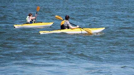 Garden Poster Water Motor sports People are playing kayak in a lake