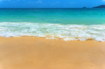 Beautiful tropical beach and sea wave on sandy shore