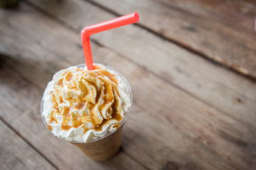 ice coffee take away on wooden background