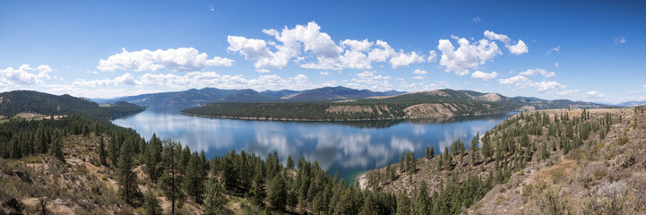 Beautiful Sunny Day Panorama of Cloud Reflection on Lake Roosevelt in Pacific Northwest