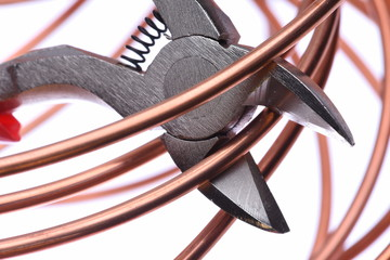 Copper wire and cutting tool close up