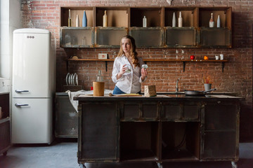 A girl in the kitchen prepares a dough