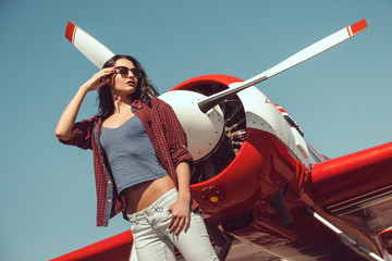 Woman pilot and airplane