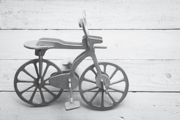 Retro wood bicycle on wood background