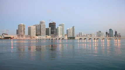 Wall Mural - Miami waterfront buildings illuminated at twilight. Florida, United States