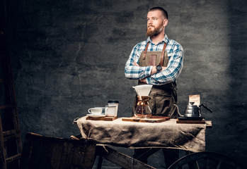 A man at the table with automatic coffee machine.