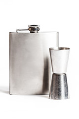 Hip flask and cups  isolated on white