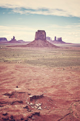 Retro stylized picture of the Monument Valley, one of the top tourist attractions in USA..