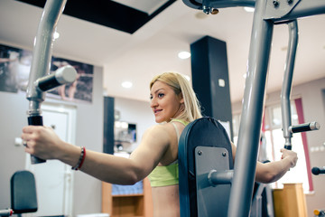 Girl having training at gym
