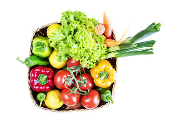 Wall Mural - Vegetables in basket on white background