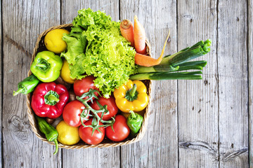 Wall Mural - Vegetables in basket on wooden table