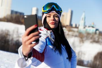 Sportswoman doing selfie on winter