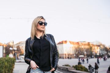 beautiful girl posing, professional model works, city walk