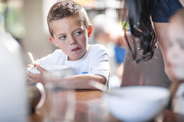 Boy eating breakfast at table