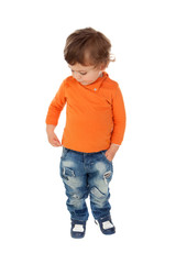 Beautiful little child two years old wearing jeans and orange jersey