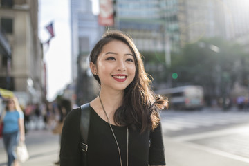 Fashionable young asian woman commuting in the streets of Manhattan (travel, journey, commute,tourism, walk,city life)