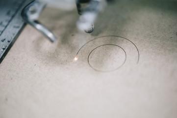 Industrial laser engraving on a paperboard