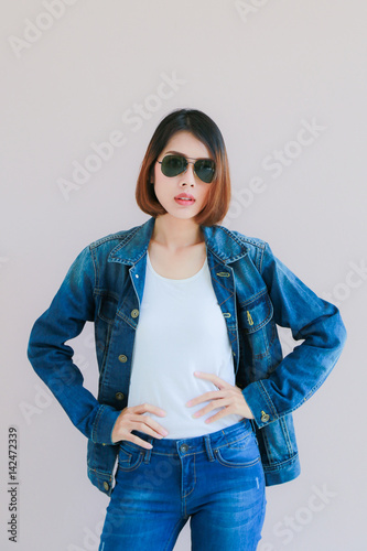 477c70e918 Asian woman casual outfits standing in jeans and blue denim shirt ...