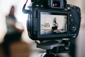 Closeup of a DSLR camera recording a video blog.