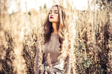 Wall Mural - Fashion beautiful lady in autumn landscape