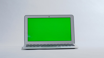 laptop on white background, green screen.