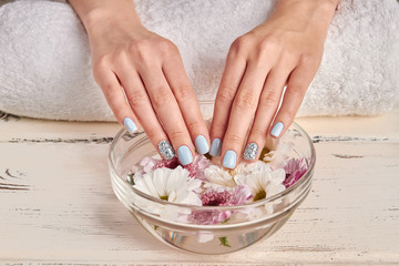 Wall Mural - Spa for hands. Delicate flowers in a glass bowl.
