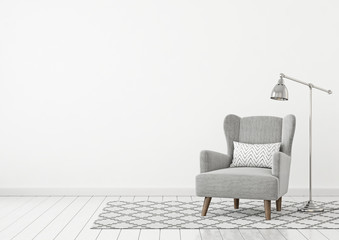 neutral classic livingroom interior with grey fabric armchair pillow lamp and nordic style rug