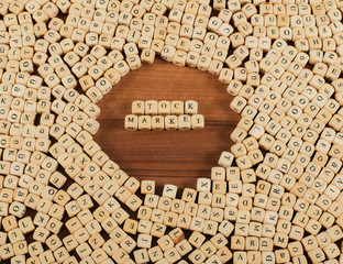 Stock Market Letters cubes on a wooden board