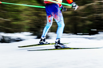 blurred image legs men skier athlete ski racing competitions