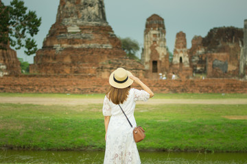 Lady tourist is watching Ayutthaya ancient city.