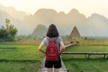 Female tourist in front of a breathtaking landscape in Vang Vieng Loas