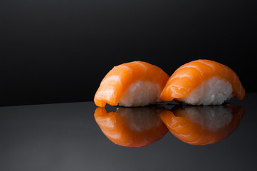 closeup of sushi with rice on grey  background with reflection