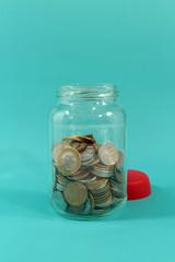 Brazilians Coins inside the glass pot