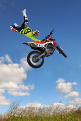 Wall Murals Motor sports Man Performing Motorcycle Stunt