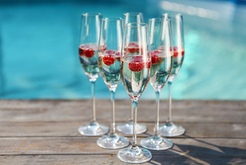 Champagne glasses with raspberry
