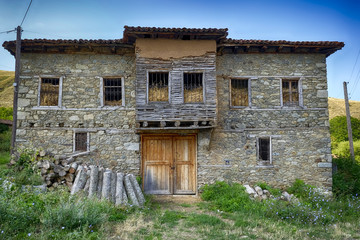 dilapidated old house filled with straw